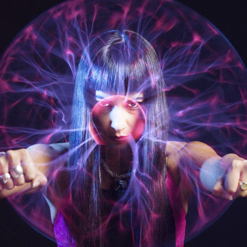 DJ Fatima Hajji looking through a plasma globe image which links to the rav3rz.com Fatima Hajji DJ profile page
