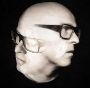 Stephan Bodzin headshot edited showing him looking in two directions at the same time